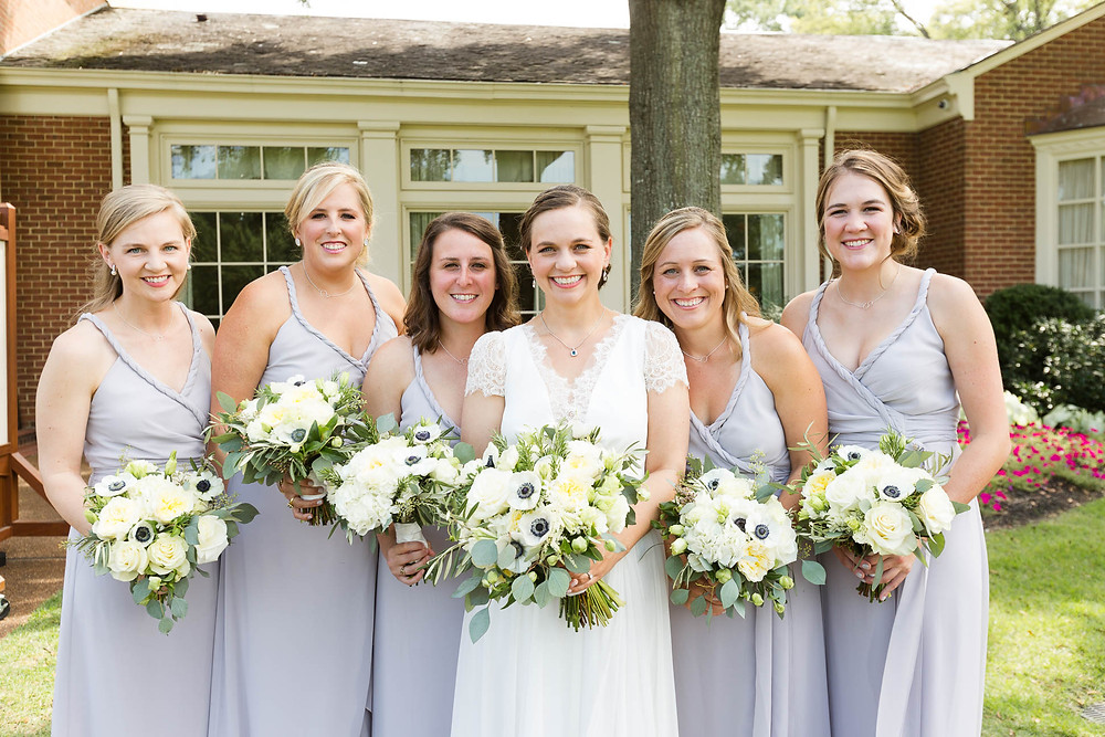 bride and bridesmaids pose for portraits at Memphis Country Club