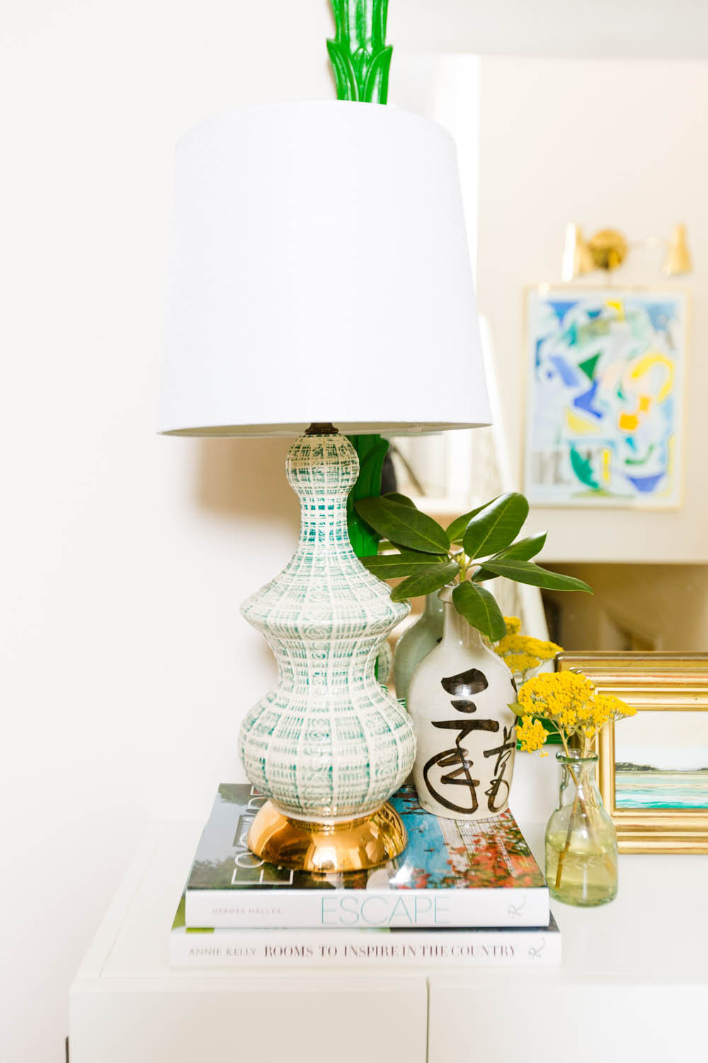 Image of lamp and art in entry way styled by Amanda Louise Interiors by photographers in greenville sc