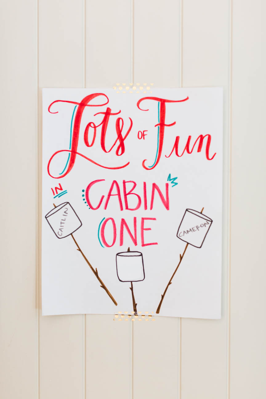 image of cabin sign for glamping party