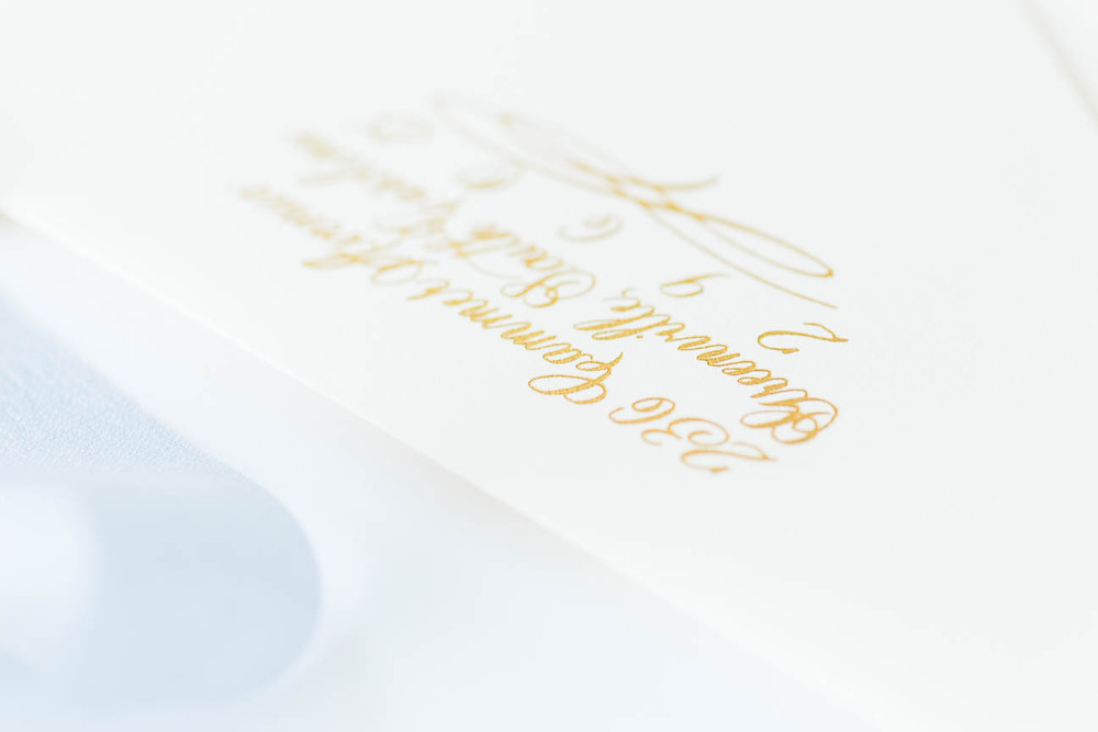 detail shot of calligraphy return address in gold