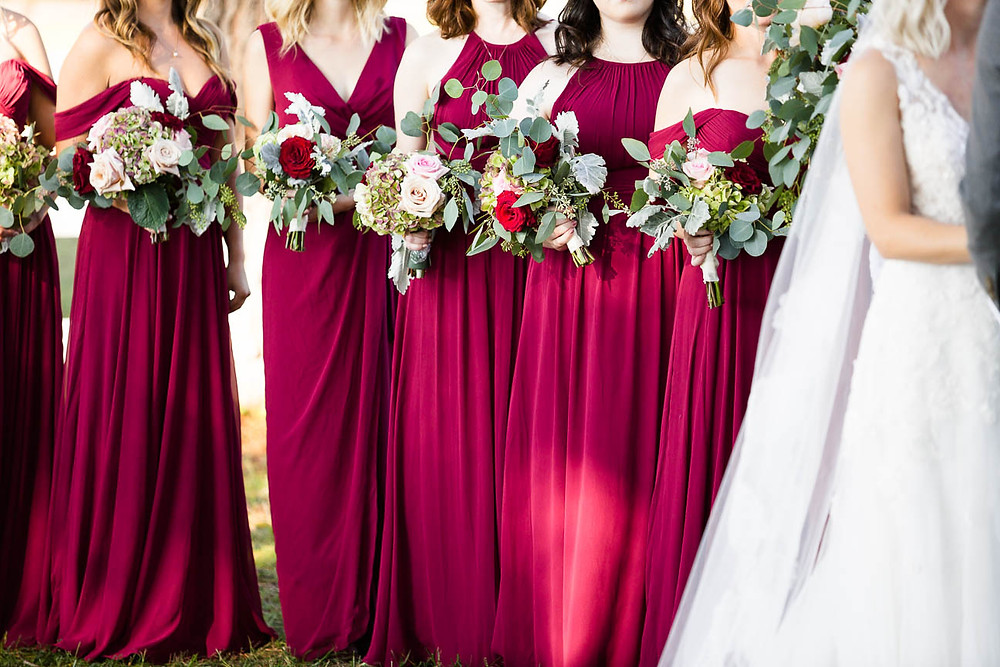bridesmaids red dresses and bouqets