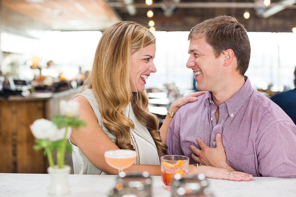 couple laughing at bar, Asheville engagement session
