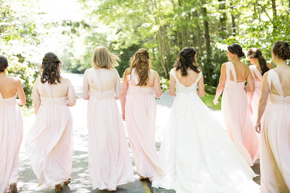 bride walks away with bridesmaids