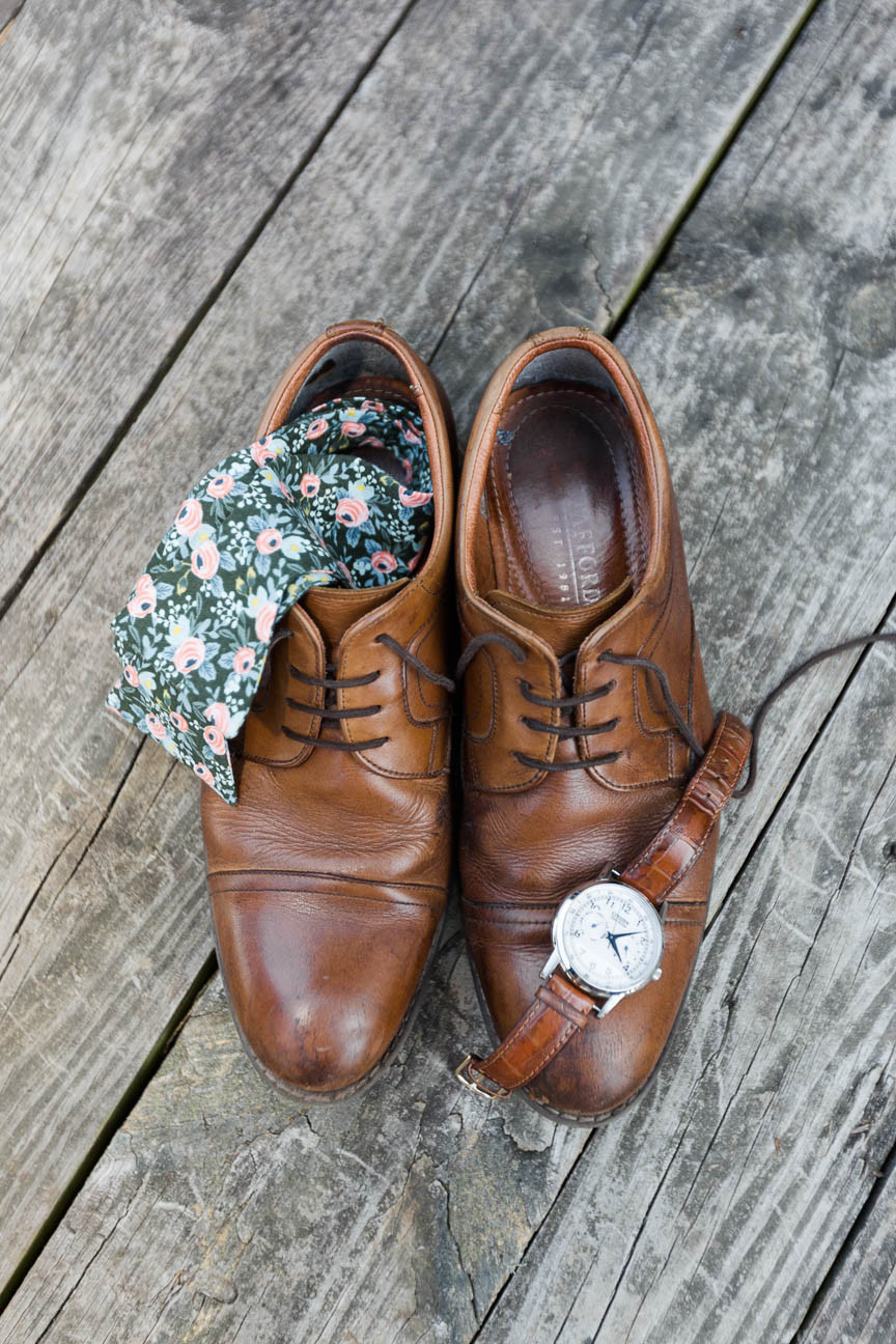 groom's leather shoes, floral bowtie, and watch detail shot