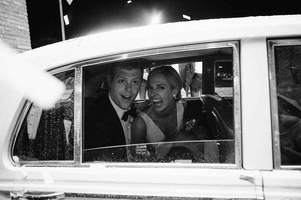 image of a couple in a vintage white car