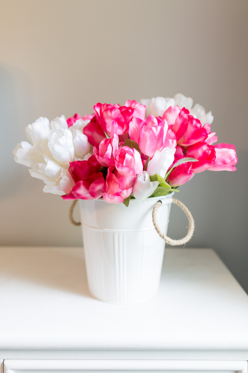 image of white and pink tulips in a white tub