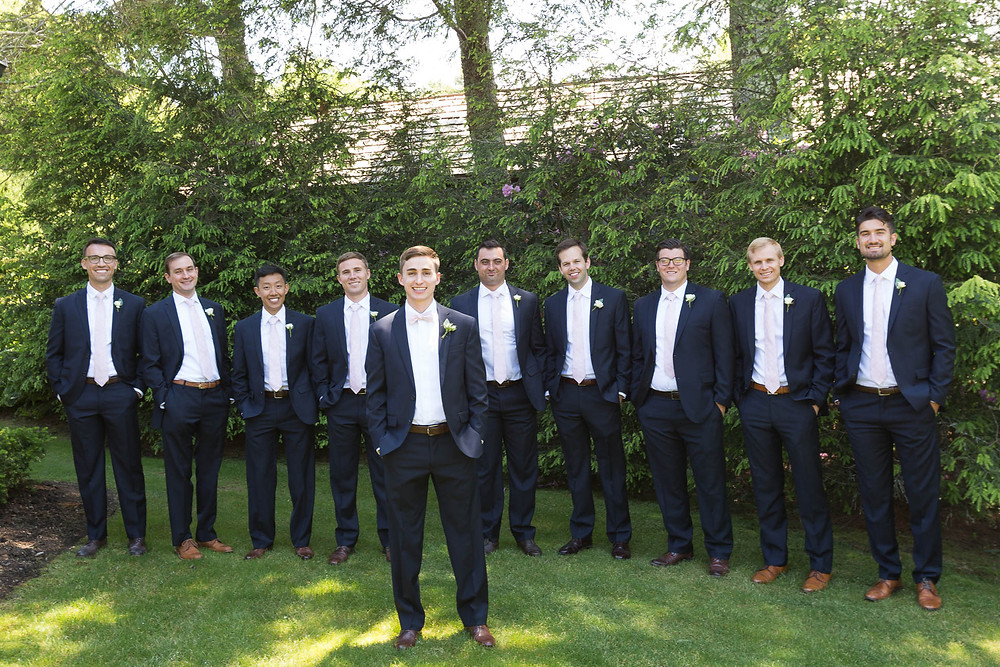 groom and groomsmen portrait with matching pink ties