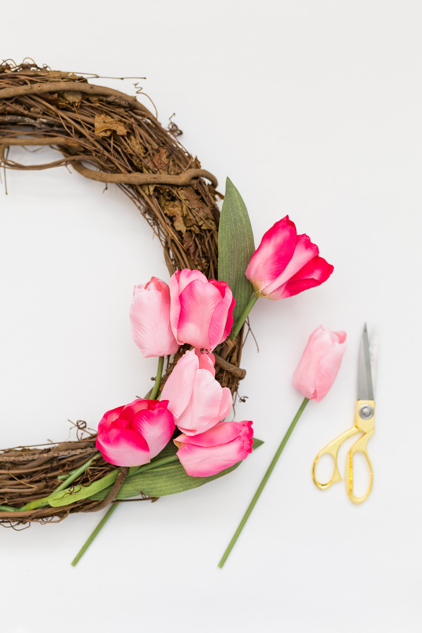 image of tulips sticking out of grapevine wreath