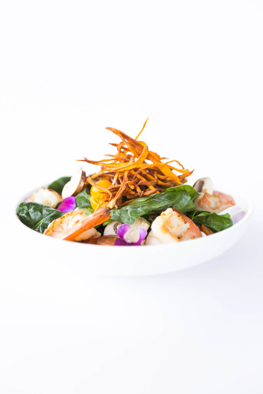 tight image of shrimp salad with sweet potatoes on top