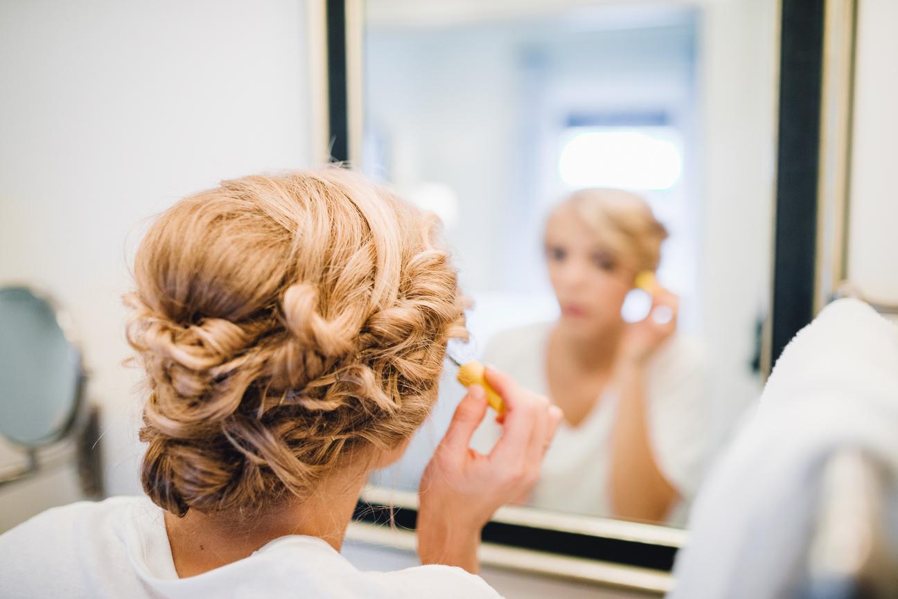 Bride puts on makeup