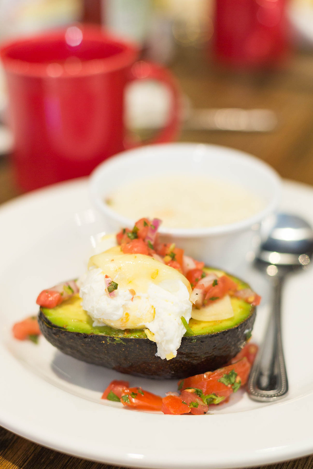 Avocado benedict with grits at Famous Toastery in Greenville SC
