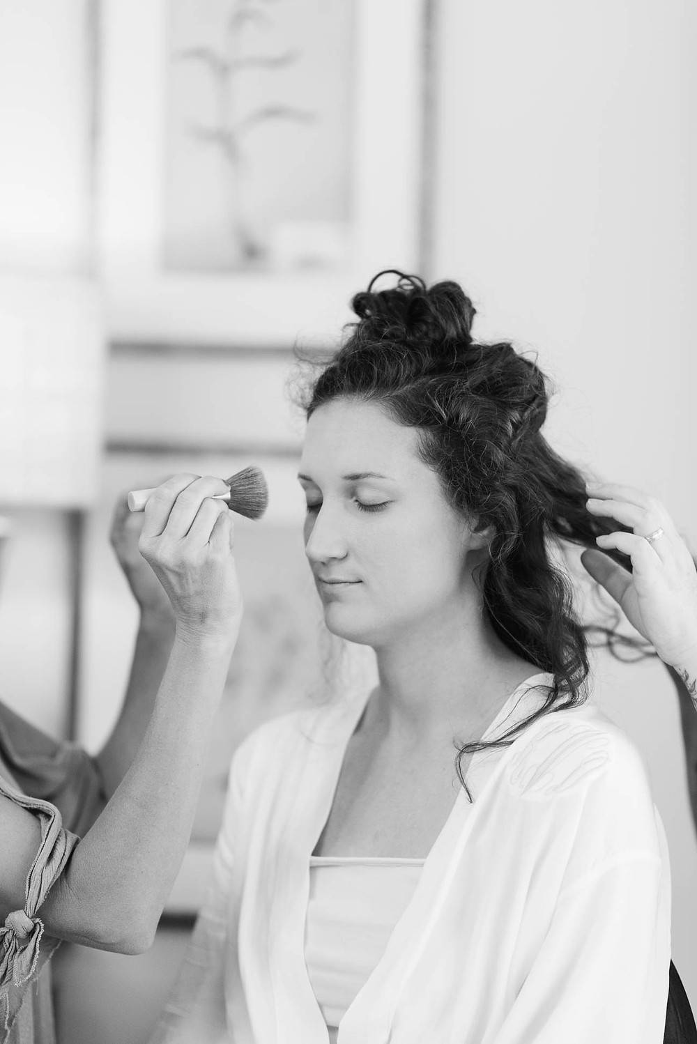 bride gets makeup done before her wedding, linville NC wedding, black and white portrait