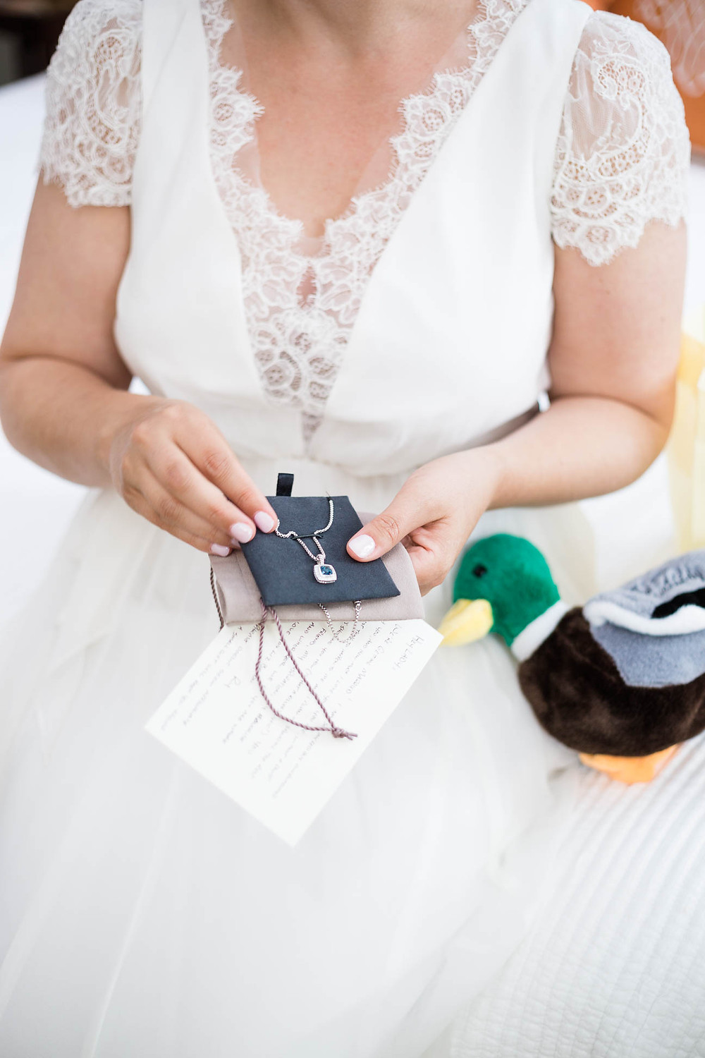 bride opens gift from groom
