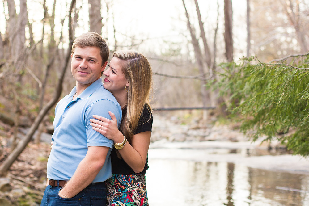 couple stands in creek, Asheville engagement session