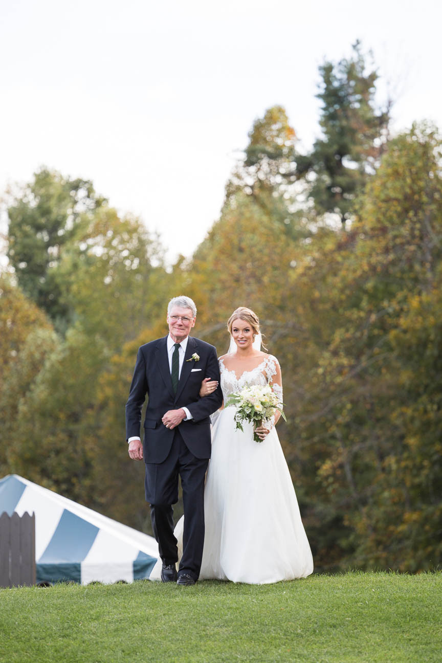father walks his daughter down the aisle during her NC mountain wedding