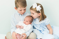 siblings with newborn baby
