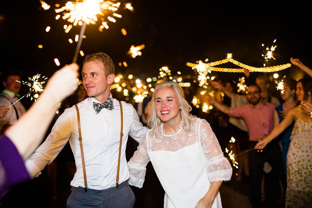 guests send off newlyweds with sparklers
