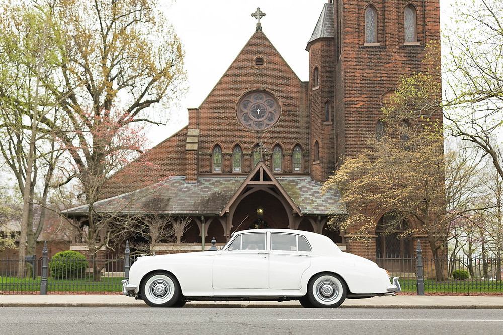 image of vintage Rolls Royce car in front of a church in Kentucky