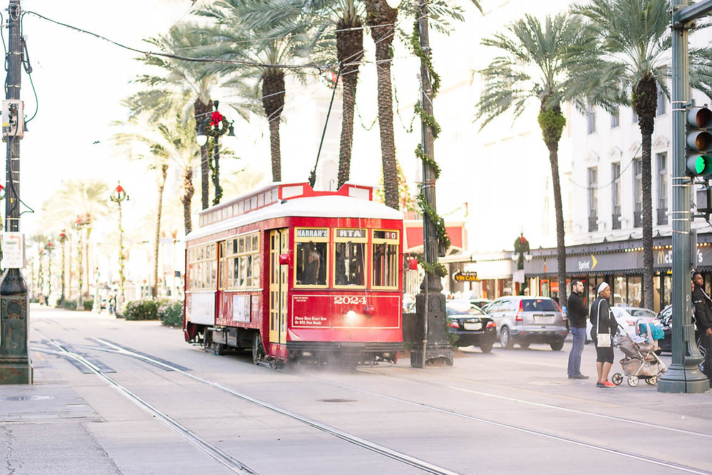 trolley driving through canal street in New Orleans at Christmas