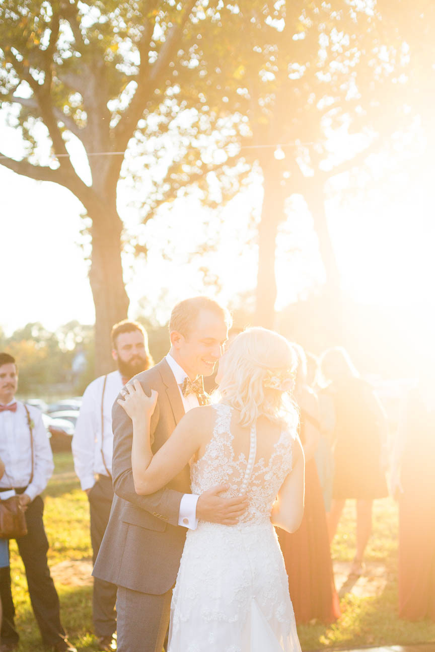 bride and groom's first dance as sun sets
