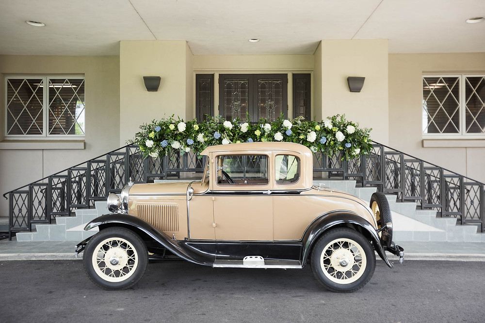 image of a tan vintage car at country club in Memphis, TN