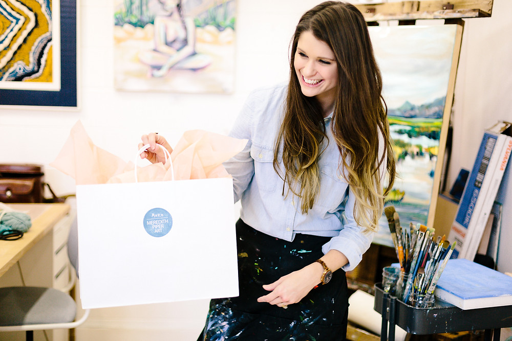 Meredith Piper gives gift bag to client, Greenville SC Artist