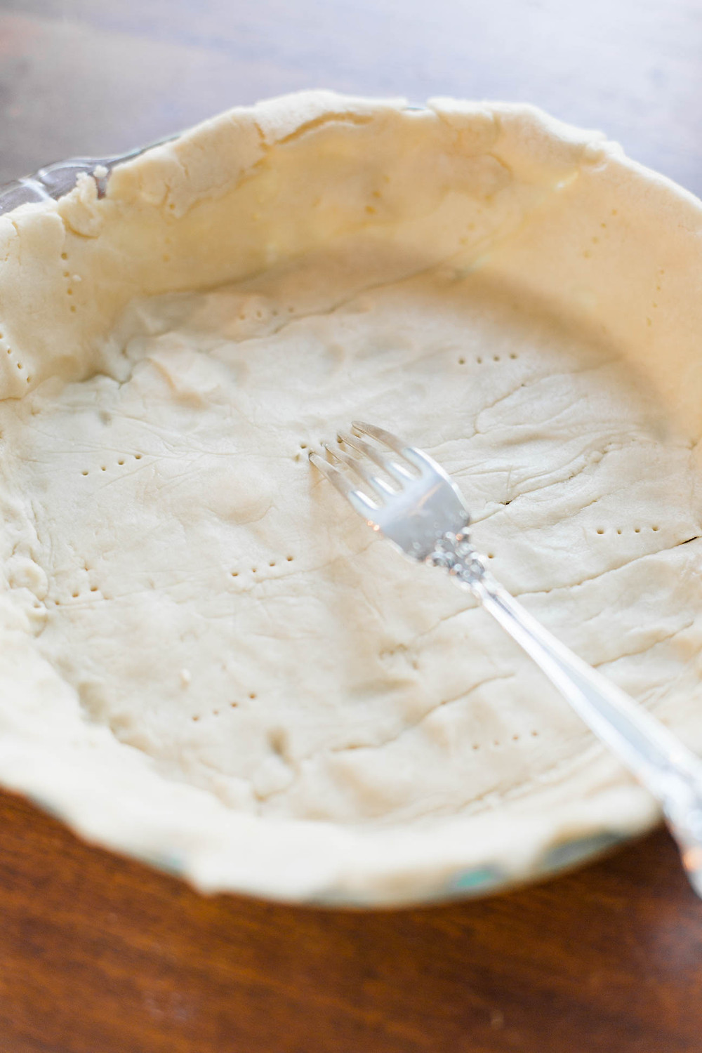 raw pie crust with fork holes