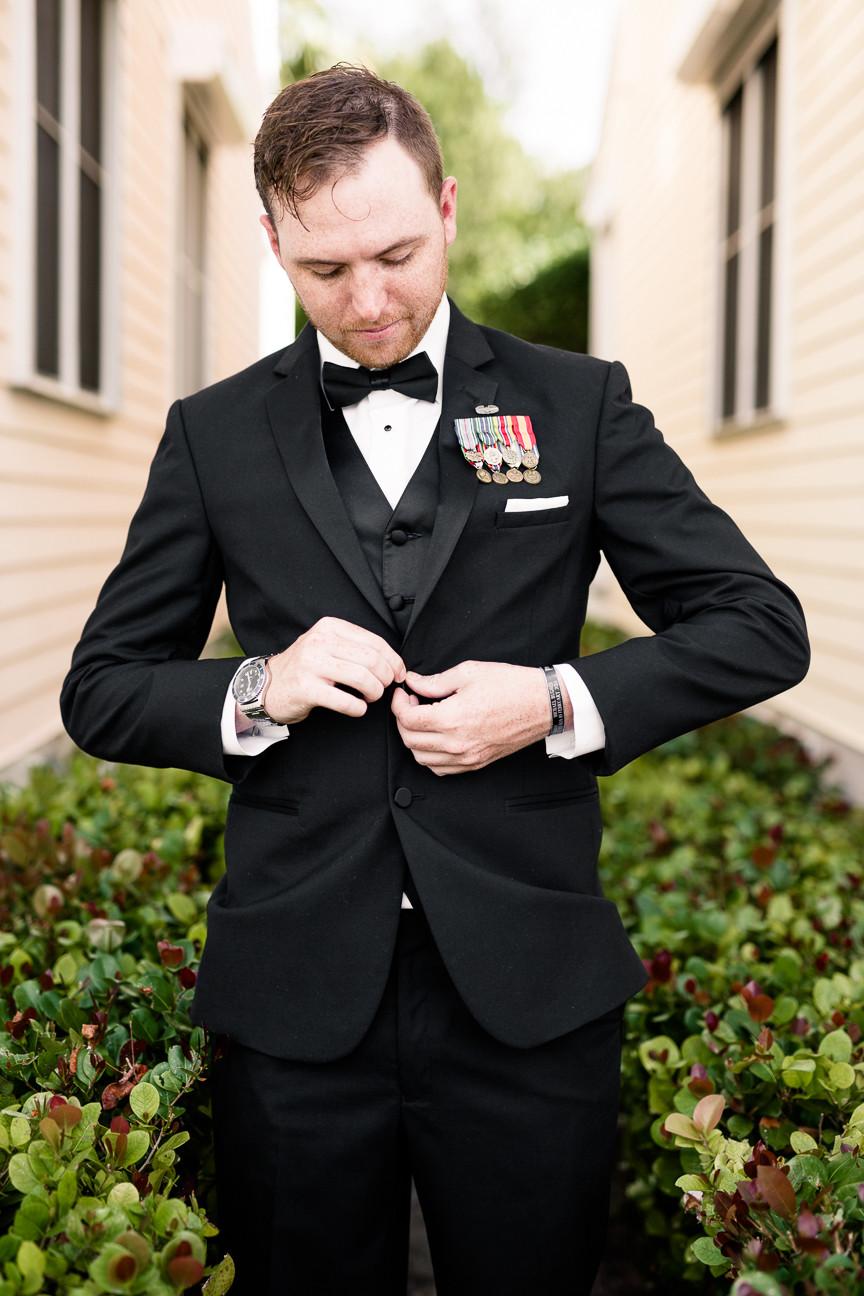 portrait of groom buttoning jacket, destination wedding, southern weddings, wedding photography