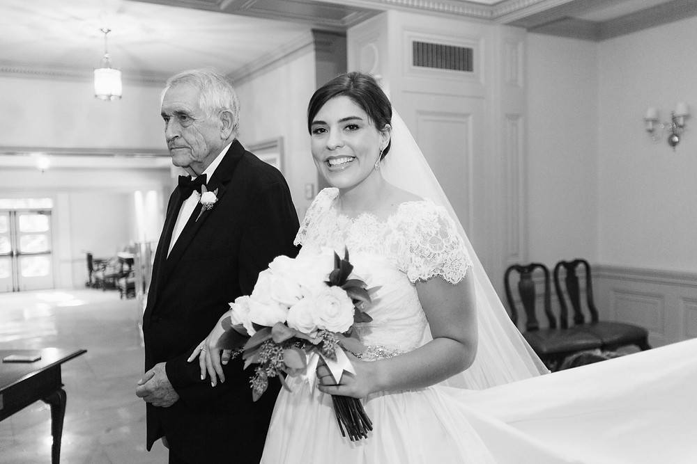 bride stands with her grandfather before he walks her down the aisle of the church