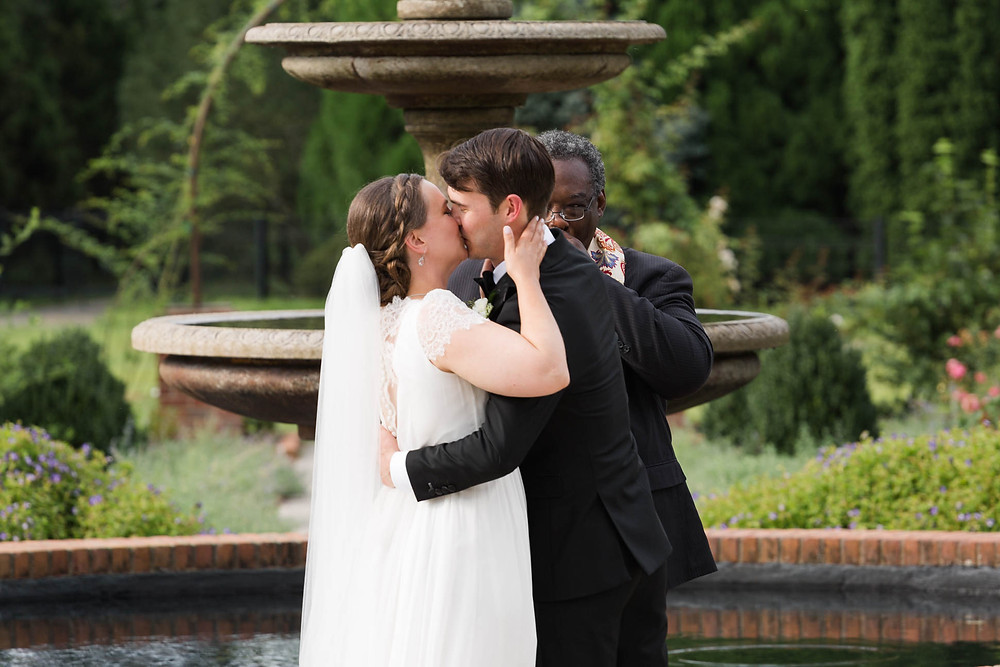 newlyweds first kiss during their ceremony