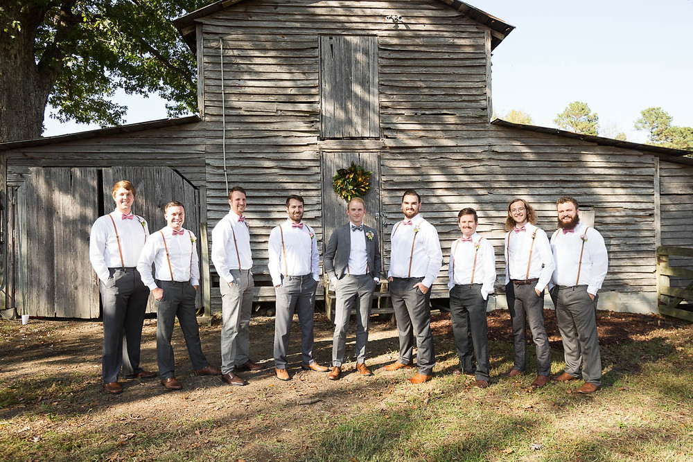 groom and groomsmen portrait in front of tobacco barn in NC