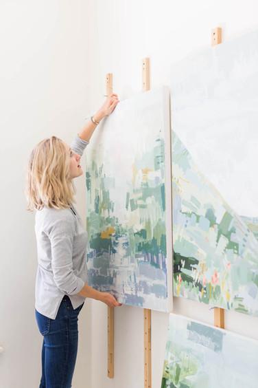 Brevard-NC-artist-hangs-paintings-in-stu