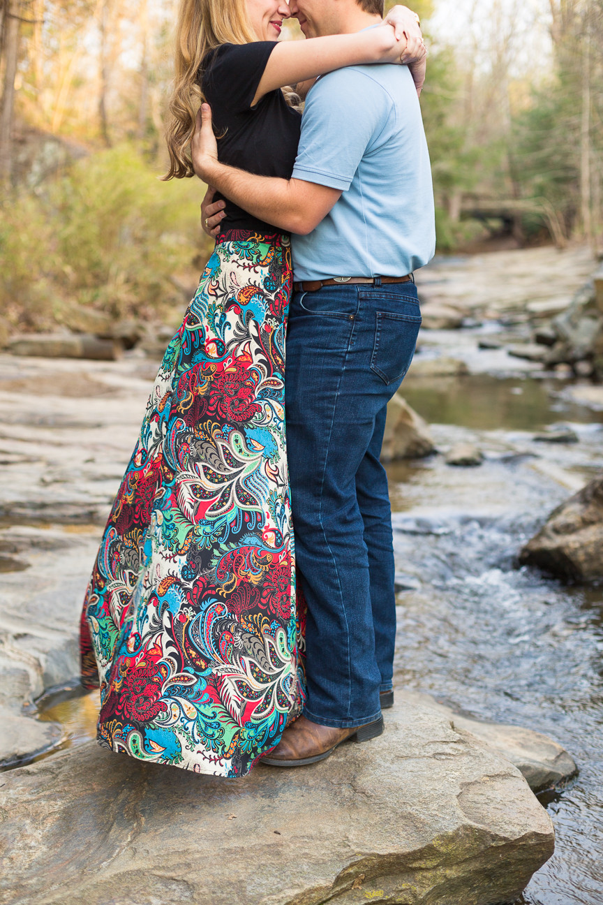 couple hugging in creek, Asheville engagement session