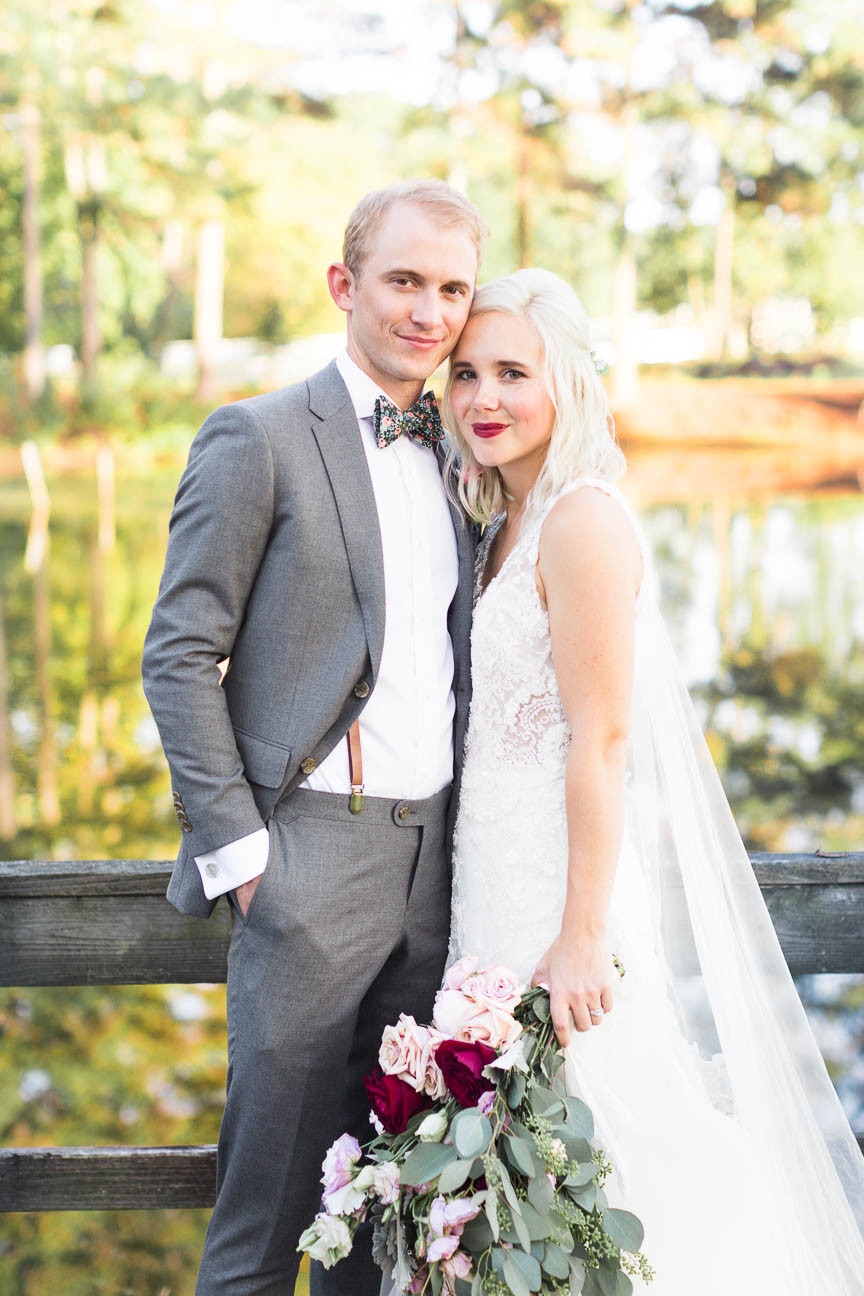 bride and groom on a private dock