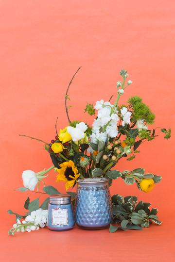 Blue-candle-on-orange-backdrop.jpg