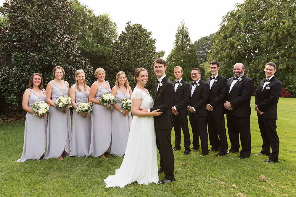 portrait of bride and groom with their wedding party