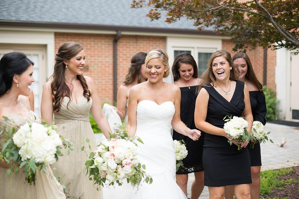 bride walks through courtyard on her wedding day