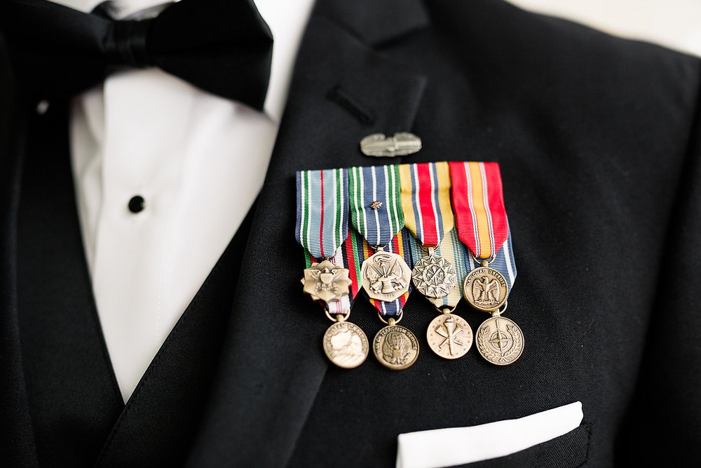 groom's lapel, army medals, groom prepares for wedding ceremony, destination wedding, southern weddings, wedding photography, detail shot