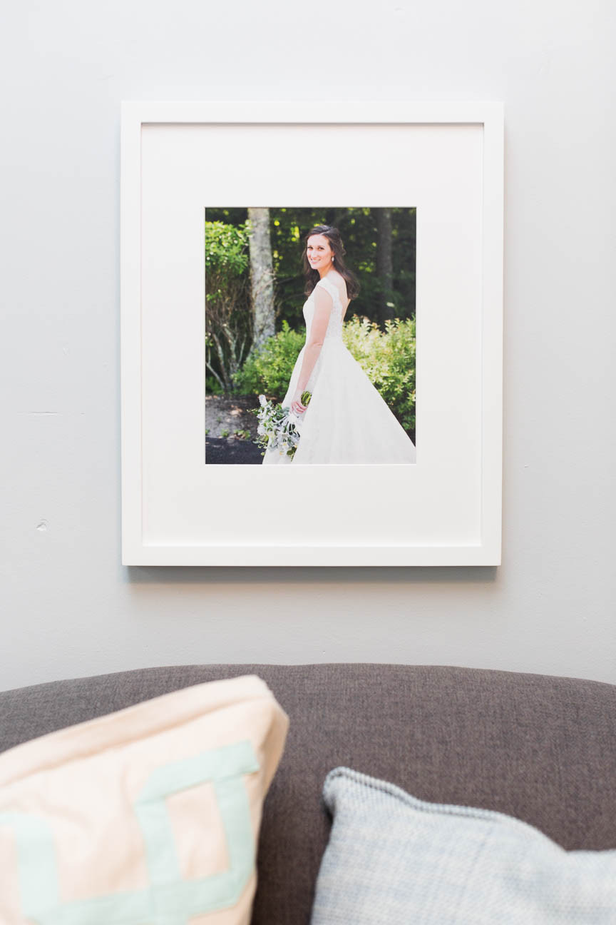 white frame with bridal portrait hanging above couch