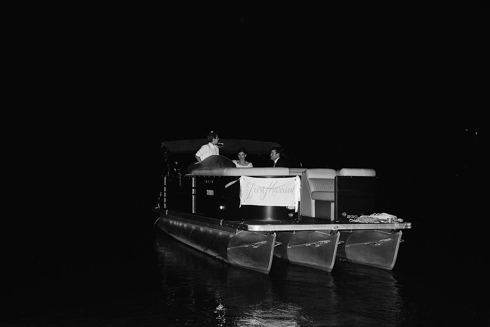 image of couple in a just married boat on Lake Hartwell