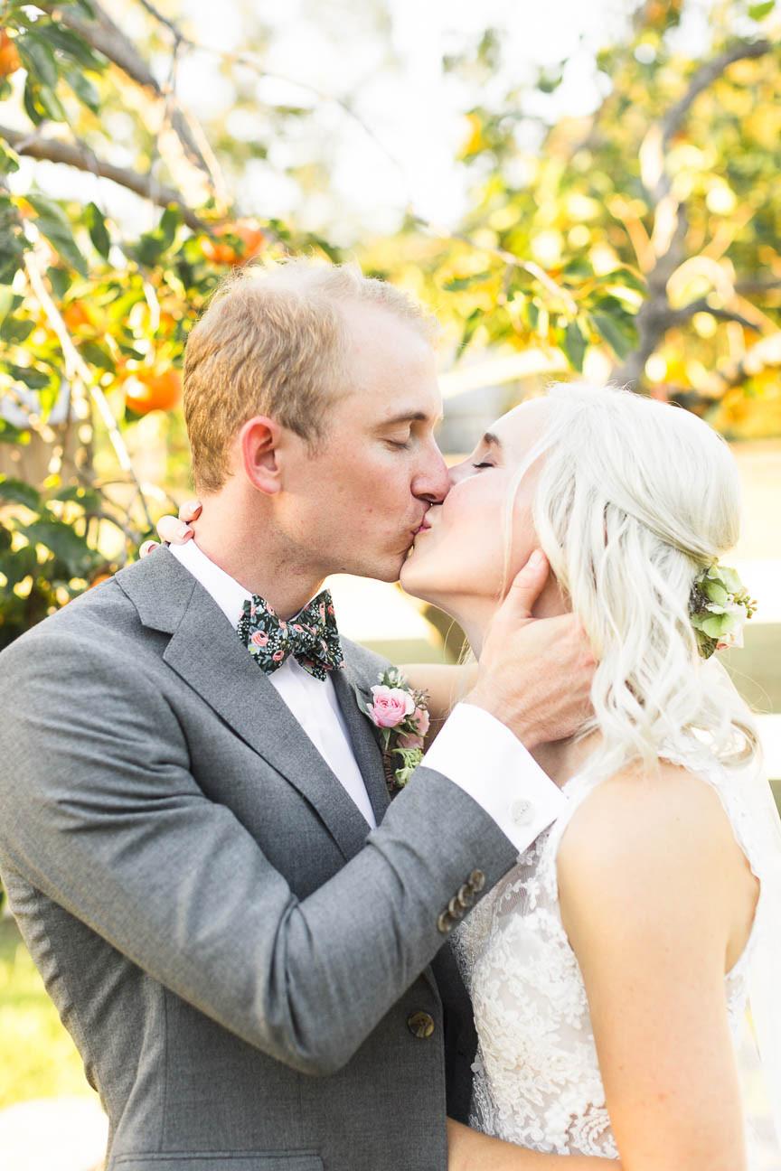 newlyweds kiss on farm in NC