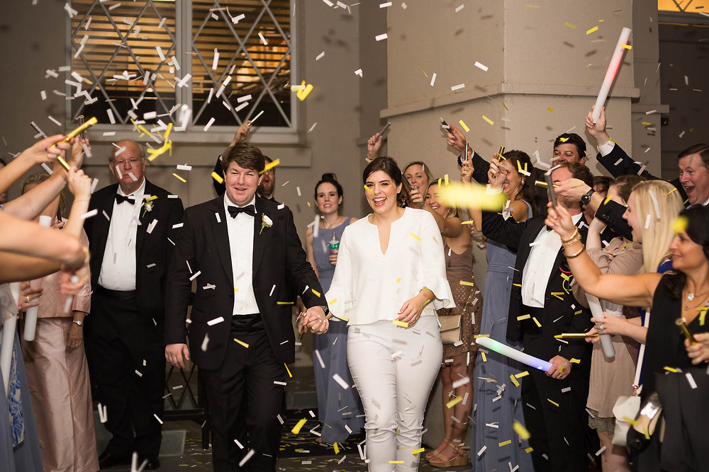 bride and groom have a confetti send off after their wedding