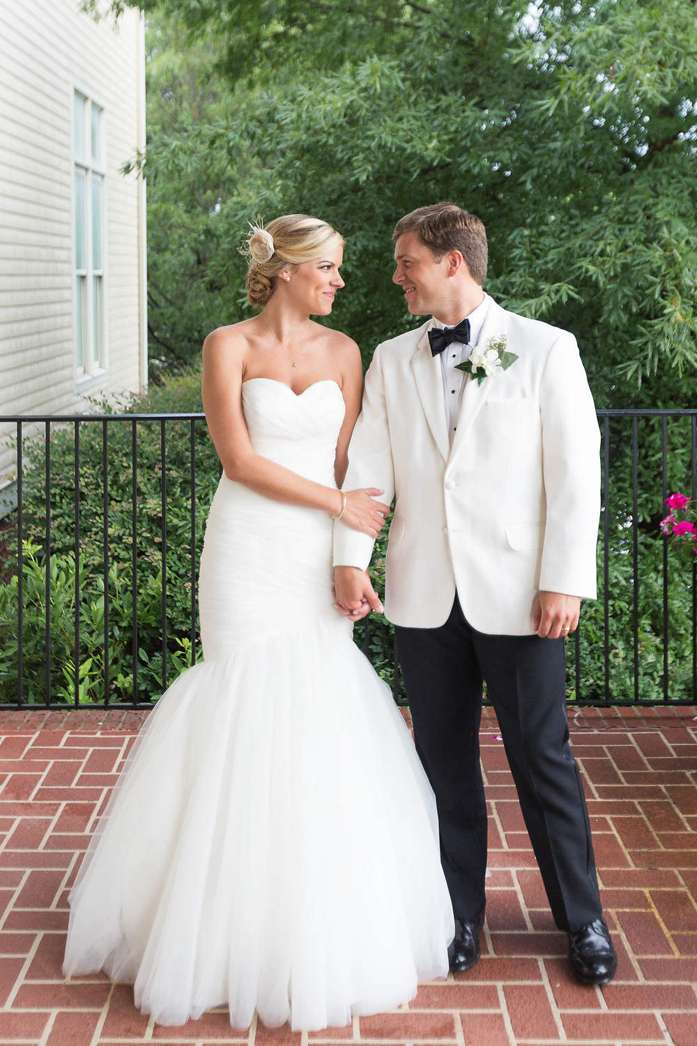 portrait of bride and groom on a porch after their wedding ceremony