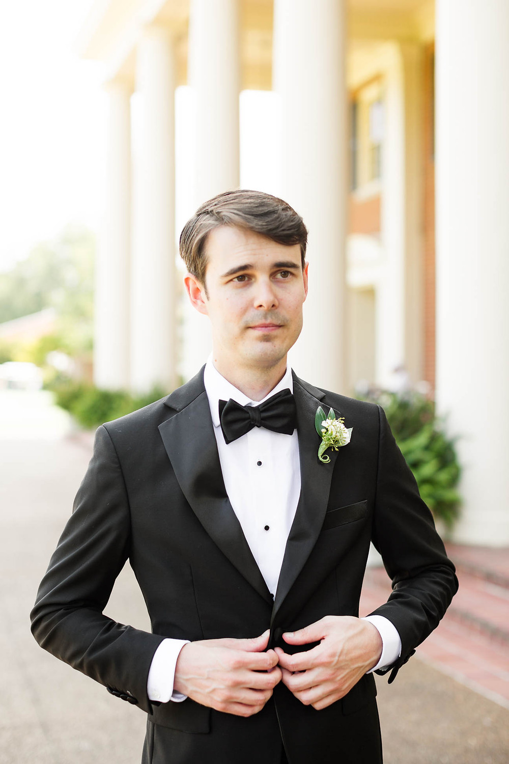 portrait of groom outside on his wedding day