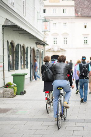 people bike through the streets of Europe