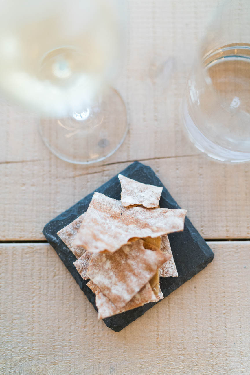 crackers and wine during a tasting at Vassaltis Winery in Oia, Greece