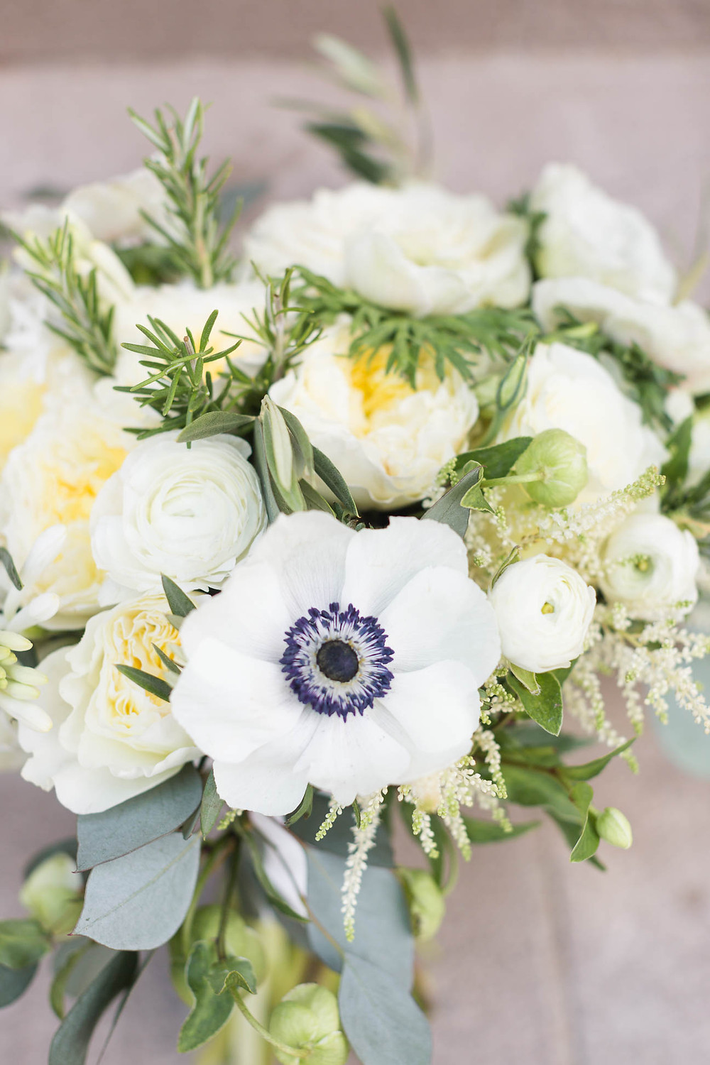 bridal bouquet with roses and ranunculus