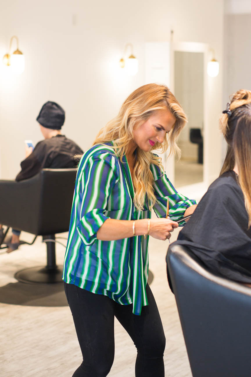 Jessica gives hair cut at her Greenville, SC salon