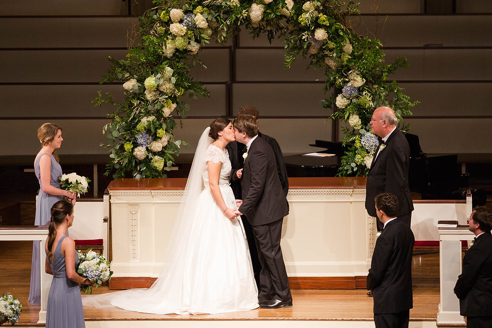 bride and groom's first kiss during their Memphis, TN ceremony