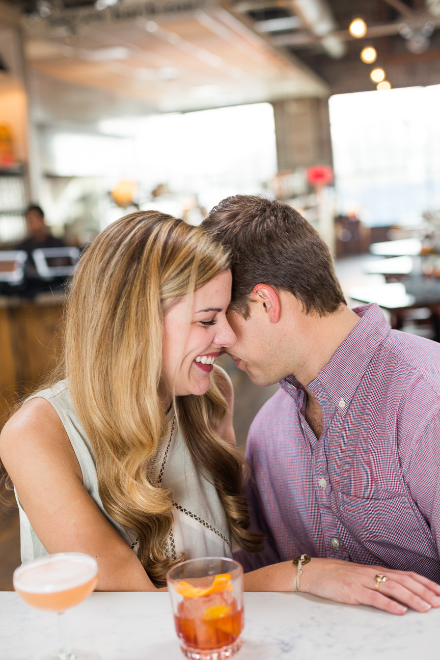 couple whispers to each other, Asheville engagement session